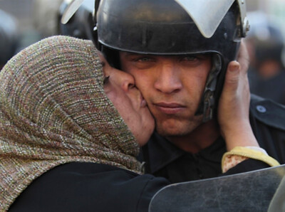 Protestor kisses Police
