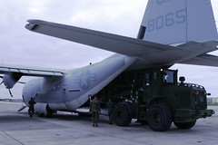 Marines load aid bound for Japan in KC-130