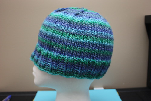 Hat with cabled/chained yarn