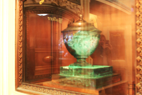 reflection of rachael in the glass over an urn