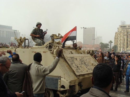 Army tank and protesters in Tahrir Square