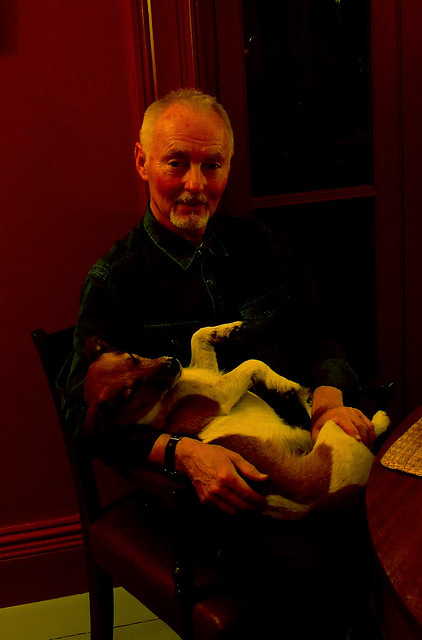 The artist and his dog at table