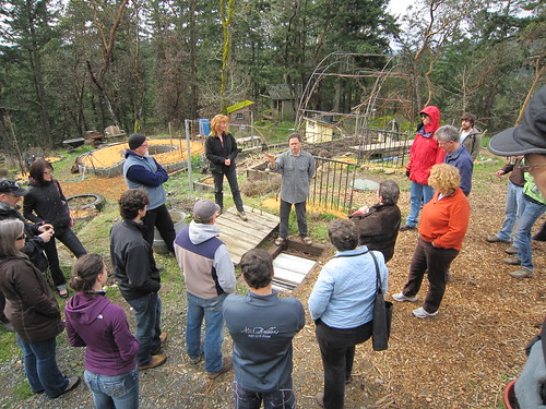 In the garden, Gord explains the role that worms play in the grey water recycling system.