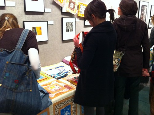 People checking out quilts + projects