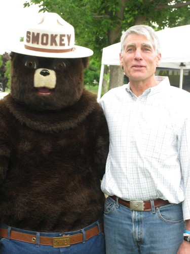 Mark Udall poses with Smokey Bear on National Get Outdoors Day