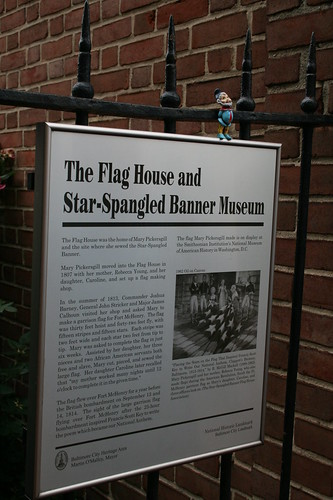 Roamy on the Flag House sign