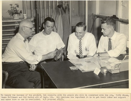 To insure the success of the project, Bob consults with men of Department 134