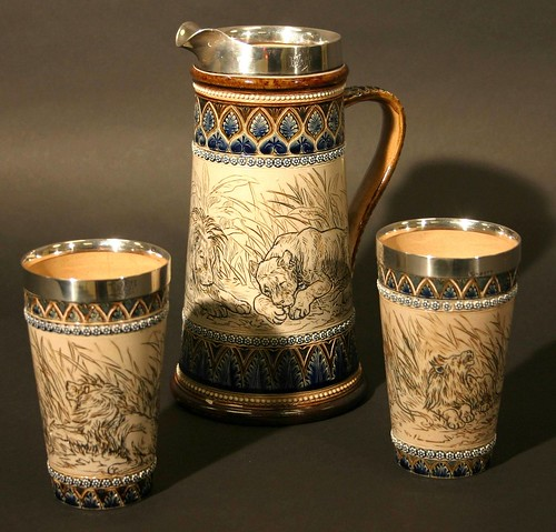A Doulton Lambeth jug and two matching beakers decorated by Hannah Barlow