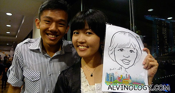 Kaili and Dennis went to get their portraits drawn