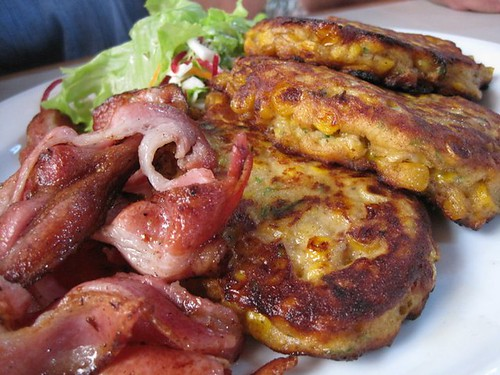 Corn fritters with baconand salad