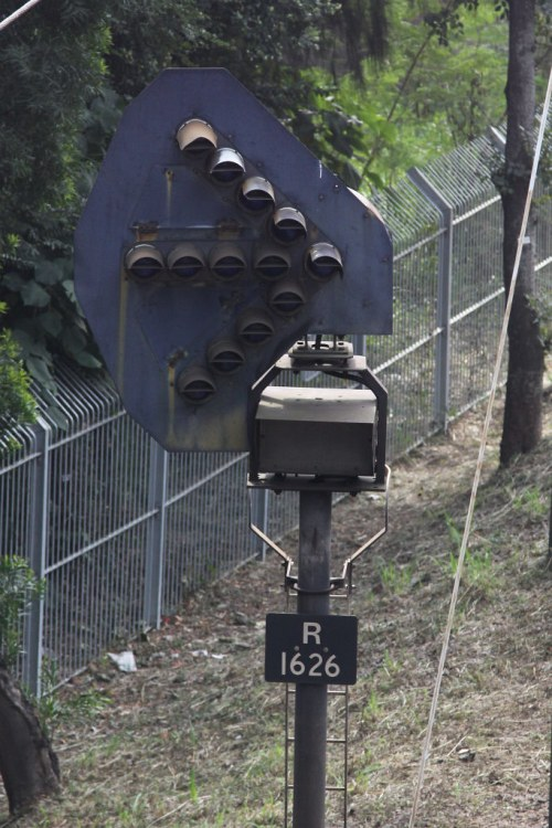 Repeater signal R1626 south of University station, before the junction for the Racecourse