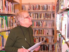 Senior volunteer searches shelf