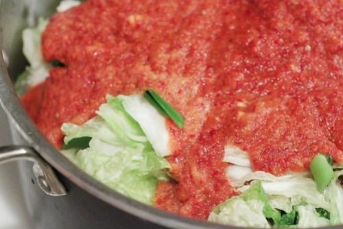 mixing up kimchi