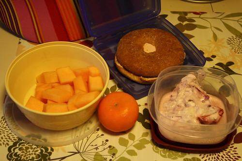 cantaloupe, clementine, yogurt, bagel with strawberry cream cheese