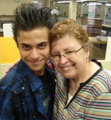 Tighe Gives Student Congratulatory Hug