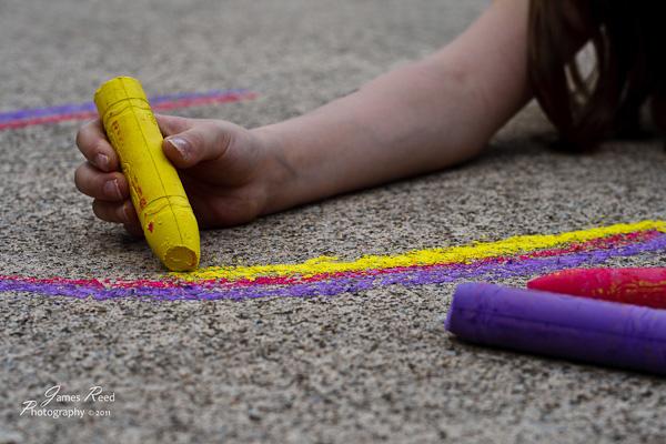 The big one creating a sidewalk masterpiece.