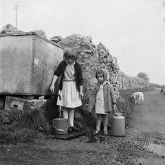 Girls carrying water, Anglesey