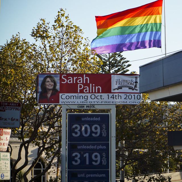 Photo of Sarah Palin looking wistfully to the Rainbow Flag. . .