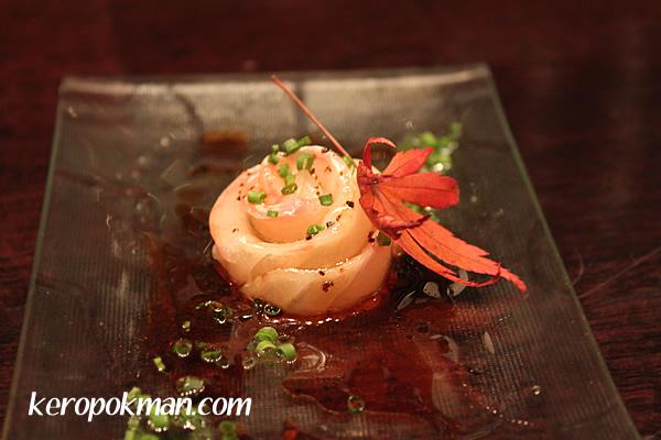 Tai Carpaccio with truffle dressing and shio konbu
