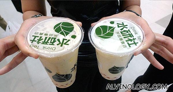 Large pudding milk tea on the left and medium roast milk tea on the right