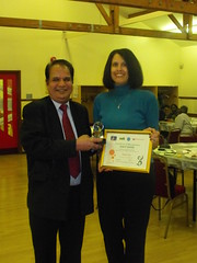 Forum secretary receiving award from Cllr Lal