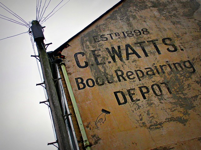 Watts Boots Repair sign in Canton