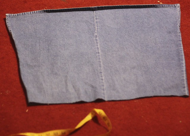 The bottom part left, destined to become two separate dresses. Note the two small slits