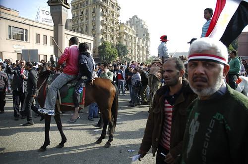 Armed pro-Mubarak men riding horses