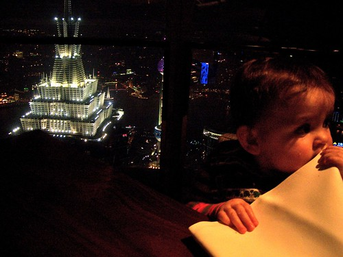 Arlo with Jinmao Tower below her