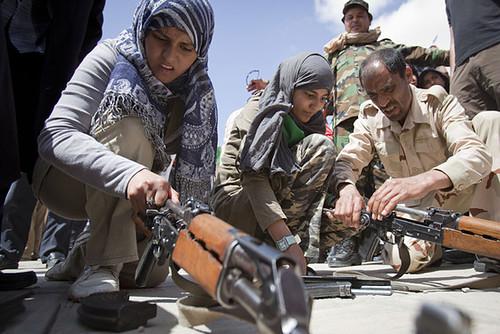 Libyan students training in the use of arms to defend their country against the imperialist forces of the U.S. and NATO as well as the rebels that are backed by the West. The government is handing out weapons to the people anticipating an invasion. by Pan-African News Wire File Photos