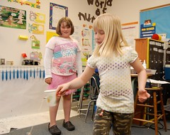 Article image: Rose M. Gaffney Elementary School third graders demonstrate the ball-in-the-cup game for the education Commissioner.