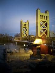 reflection of room on window looking at bridge