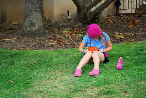 playing with her DSi in the park