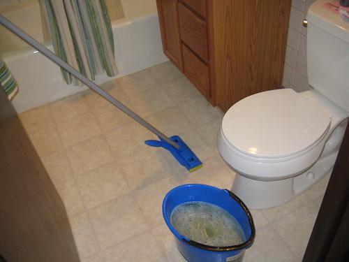 mop and bucket in bathroom