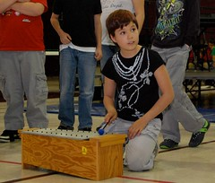 Article image: A student performs on a xylophone during a concert for family and friends at Beatrice Rafferty School.