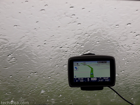 This was the TomTom GO 750 GPS that we used in Germany back in 2011. The windscreen behind it is obscured by rain and hail - right in the middle of a hot summer's day.  The entire windscreen was obscured by the rain and hail.