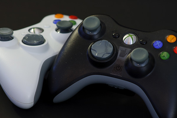 Black and white Xbox 360 controllers, the Tao of gaming.