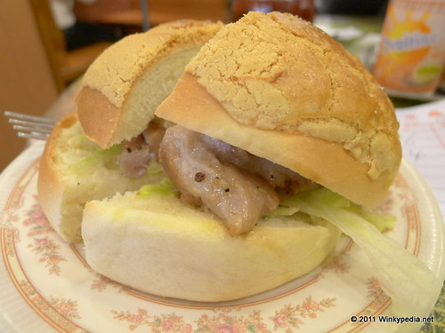 pork chop 'burger' with pineapple bun