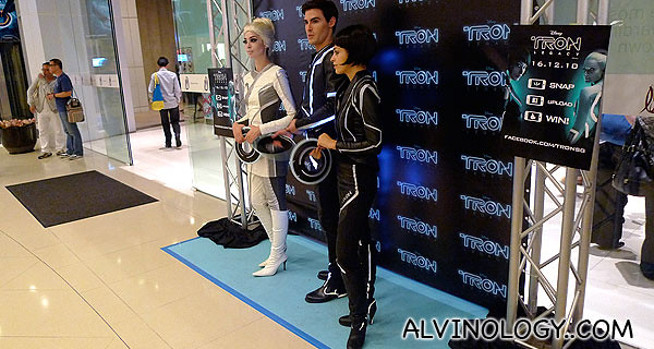 Models decked in Tron outfits at The Cathay