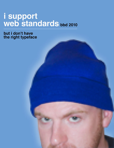 """A parody book cover of Jeffrey Zeldman's 'Designing with Web Standards. The text reads """"I support web standards"""" """"bbd 2010"""" """"but I don't have the right typeface"""" and a very pixelated photograph of John Morrison wearing a blue winter hat."""