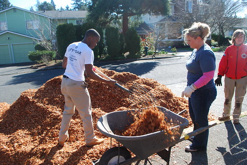 Corps Members mulching the garden