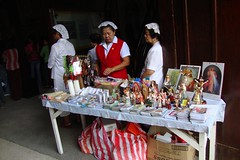 Bay's lady folk selling religious items by the church door.