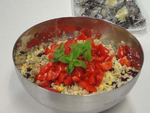 Cous cous salad with corn, raisins, tomato and mint