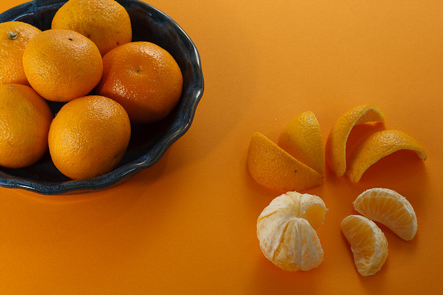A bowl of clementines, plus one.