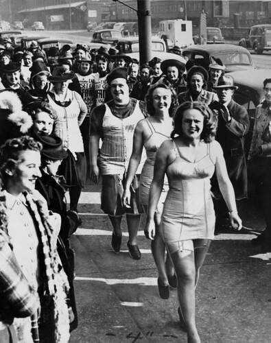Women corset workers on strike walk down the s...