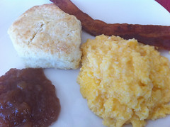 Full Holiday Brekkie: Cheese Grits, Homemade Buttermilk Biscuits and Apple Butter, with Crisp Bacon