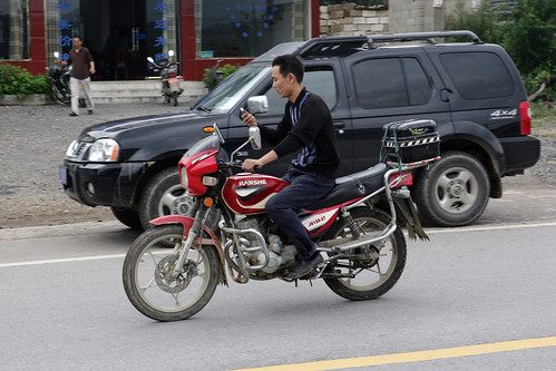 Motorcyclist using cellphone