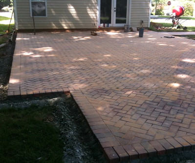 How to install a brick patio yourself pathway cafe to make the cuts hopkins came up with a template so that every brick that was cut at a 45 degree angle looked like every other cut solutioingenieria Choice Image