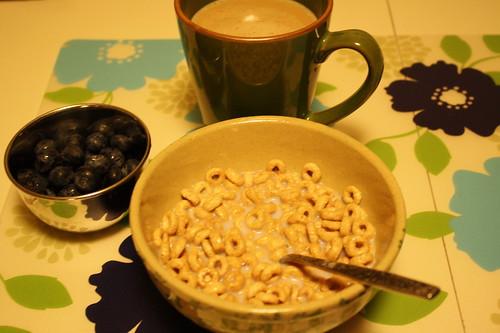 honey nut cheerios, bleuberries, coffee