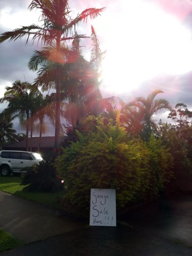 Garage sale sign among the palms